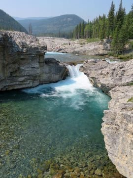 Scenic view of Elbow Falls and mountains in Kananaskis AB