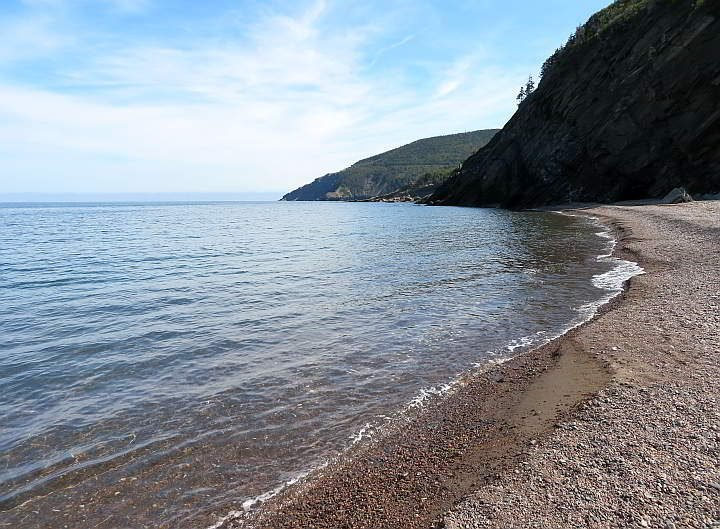 Meat Cove Beach with gentle waves of the Gulf of Saint Lawrence on a sunny summer day