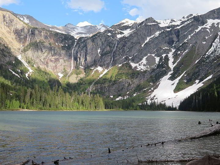 Amazing view of the Rocky Mountains and the lake at the summit of Avalanche Lake hike in West Glacier
