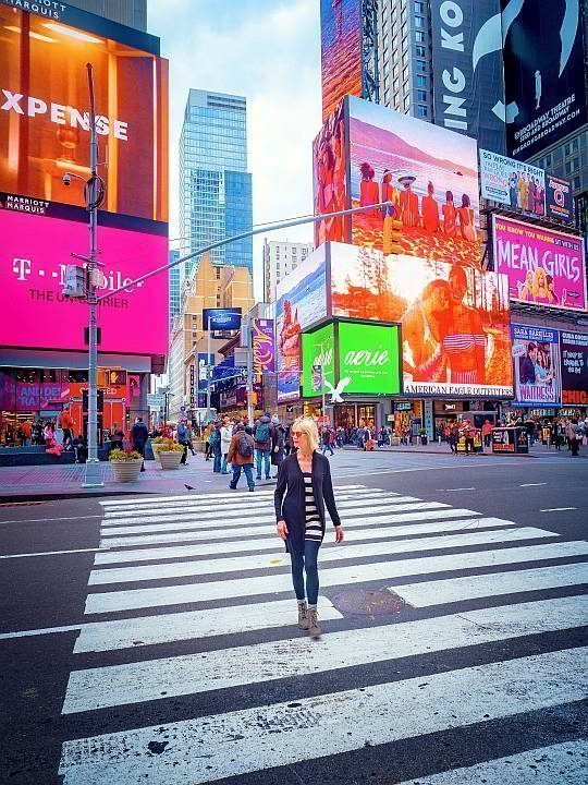 Boomer solo traveler at Time's Square New York USA