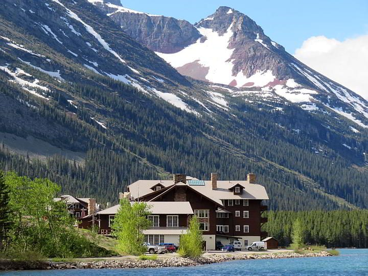 East Glacier Lodge sits on the edge of Swiftcurrent Lake surrounded by mountains in East Glacier