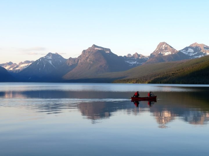 Canoeing on Lake McDonald at dusk in Glacier National Park MT