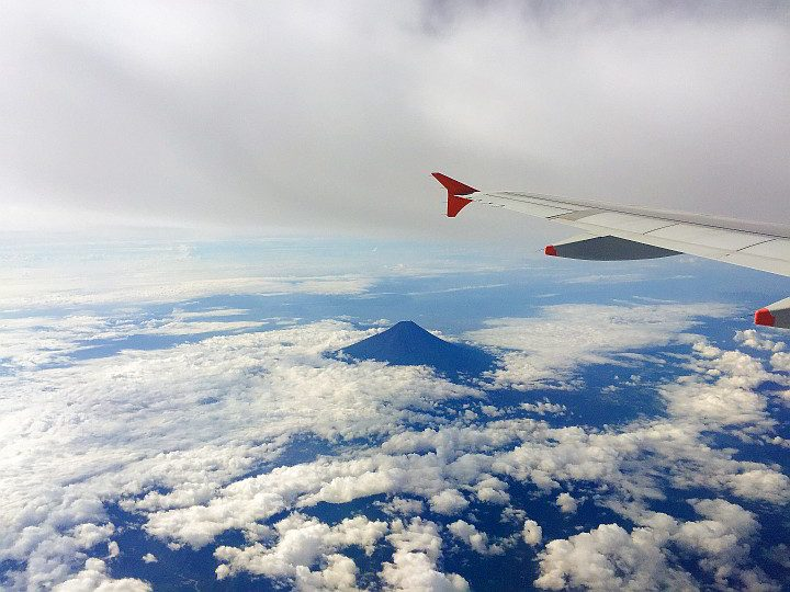 Japan's tallest peak Mount Fuji as seen from an airplane. Fuji-san is an active volcano