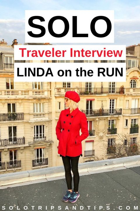 Linda on the Run in red jacket and beret on a Paris rooftop - she shares her healthstyle and travel tips during this solo traveler interview