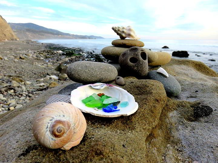 Beachcombing treasures of colorful beach glass and shells on display at the Carpinteria Bluffs beach