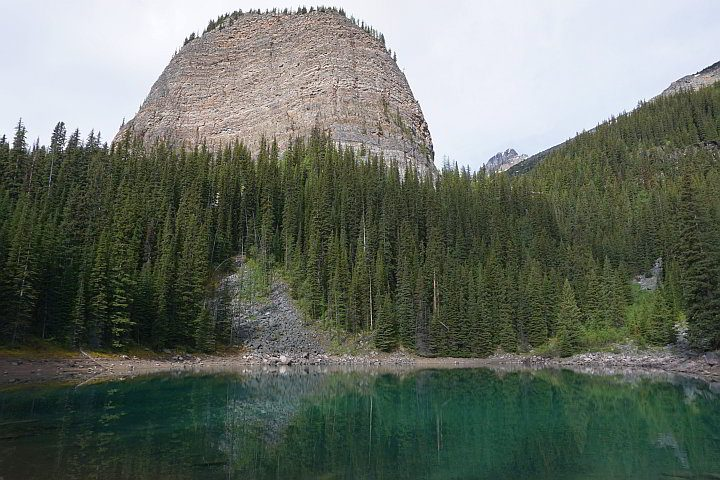 Big Beehive mountain seen from Mirror Lake along the tea house hiking trail in Lake Louise