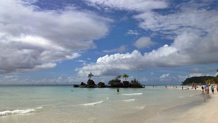 On any Southeast Asia trip solo travelers find Boracay Philippines beaches a great place to meet others