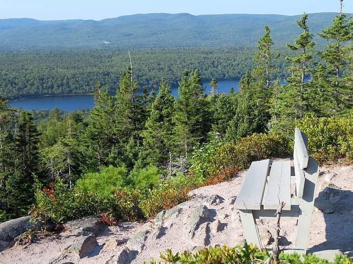 A bench at Broad Cove Mountain summit offers beautiful views of Cape Breton