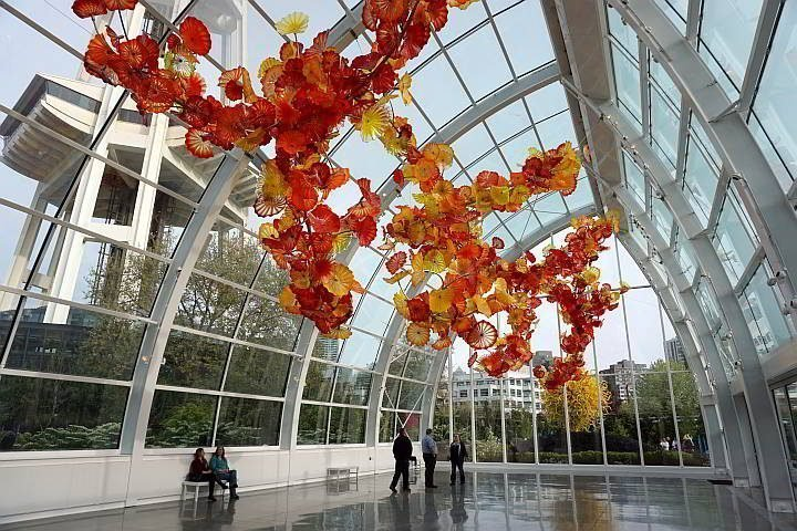 Inside Chihuly Glass and Garden clusters of glass art hangs from the atrium
