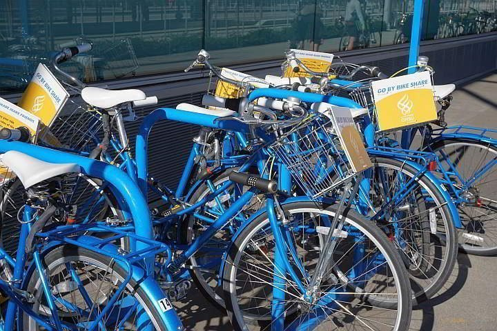 Bright blue bicycles of the Go By Bike Share program in Portland Oregon