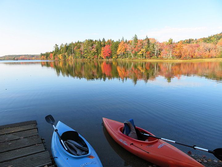 Kayaking with fall foliage and the incredible reflection of the trees on the water