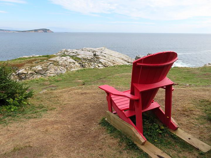 One of Canada's red chairs at the summit of Middle Head Trail in Cape Breton