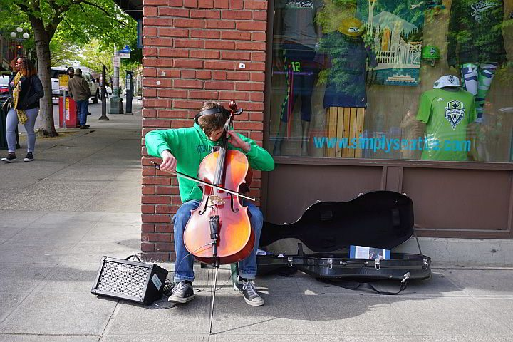 Street musician in downtown Seattle playing a cello