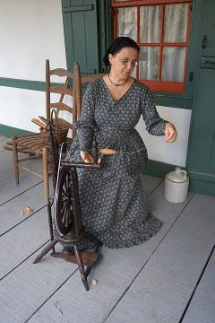 Spinning yarn at Vermilionville Historic Village - a living history museum in Lafayette