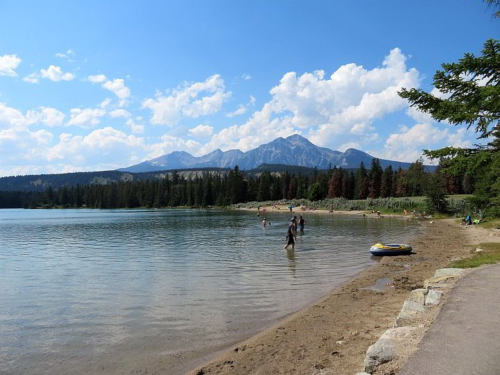 People enjoy swimming at Lake Annette in Jasper Alberta