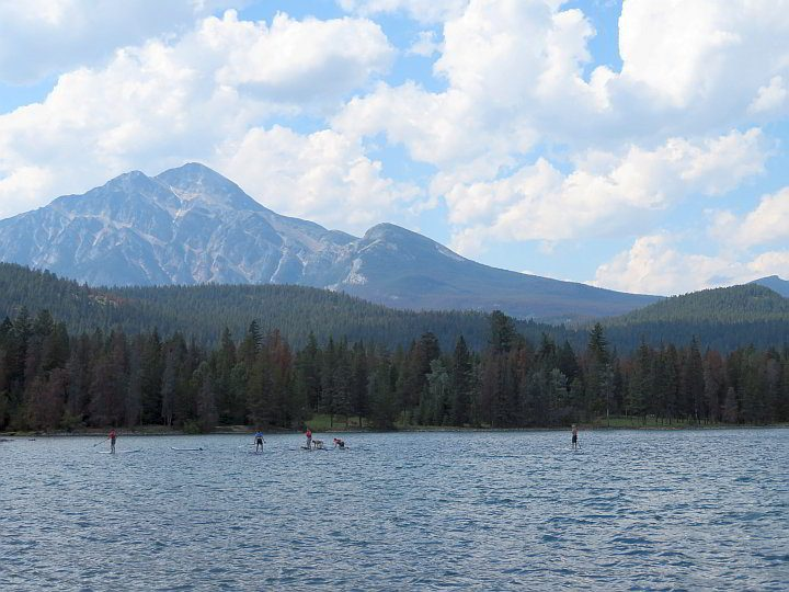 A group learns how to Stand Up Paddleboard (SUP) at Lake Edith in Jasper