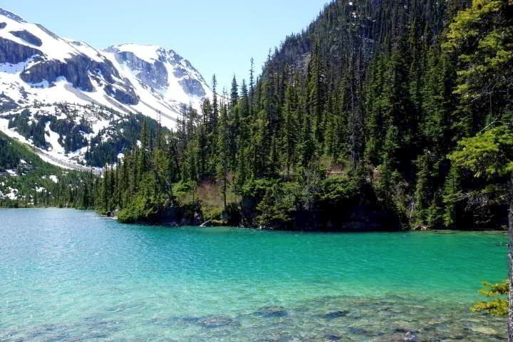Spectacular color of Upper Joffre Lake and snow covered mountains are your hiking reward