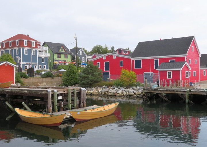 Visiting Lunenburg Nova Scotia waterfront with colorful boats and buildings