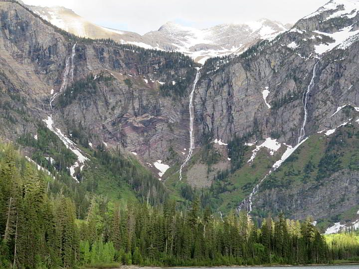 Waterfalls flow down the mountain from Sperry Glacier at Avalanche Lake hike in Montana