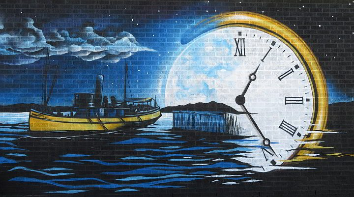 Downtown Wolfville Nova Scotia mural of boat and pocket watch
