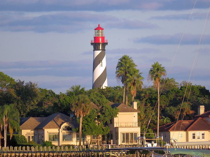 St Augustine Lighthouse with black and white striped tower and red lantern room