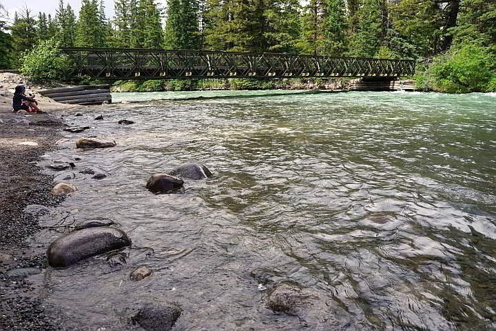 View of 6th bridge from along the Maligne River in Jasper