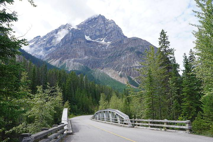 A small bridge and a mountain view in Yoho National Park