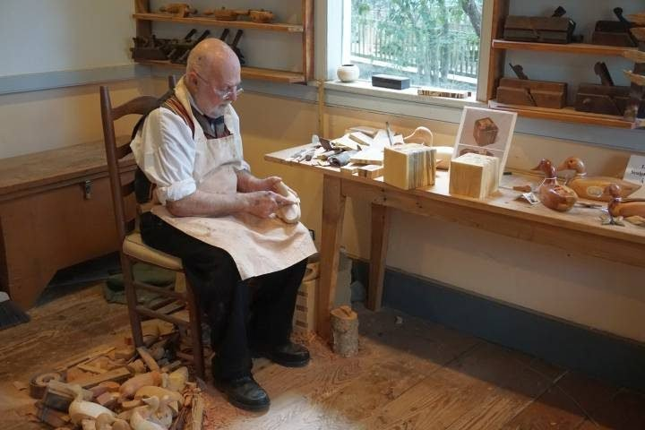 Cliff Mire - wood carver demonstrates his skills at Vermilionville museum in Lafayette