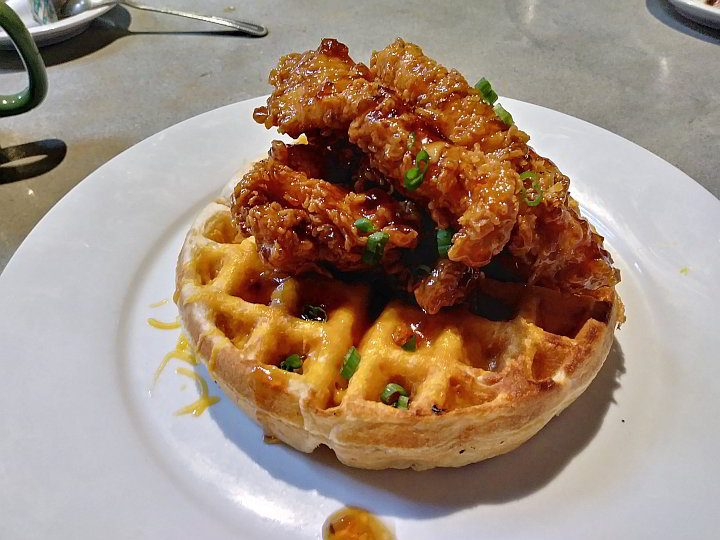 Fried chicken on top of a waffle at French Press restaurant in Lafayette LA