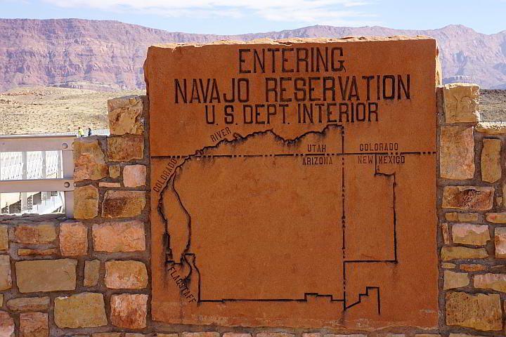 Sign at Navajo Bridge reads Entering Navajo Reservation at Navajo Bridge AZ and depicts a map of the reservation land