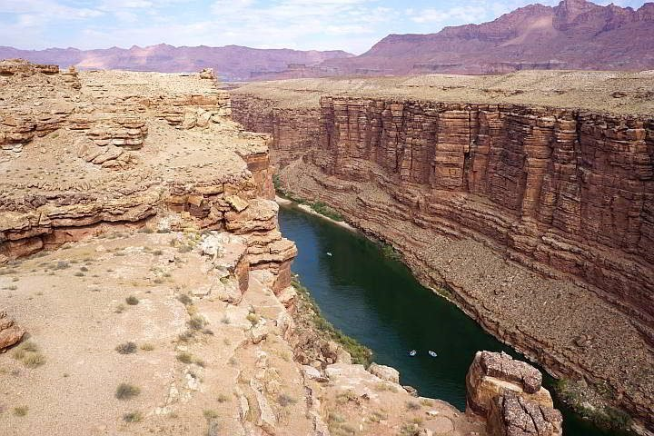 Several rafts on the Colorado River as seen from the Navajo Bridge