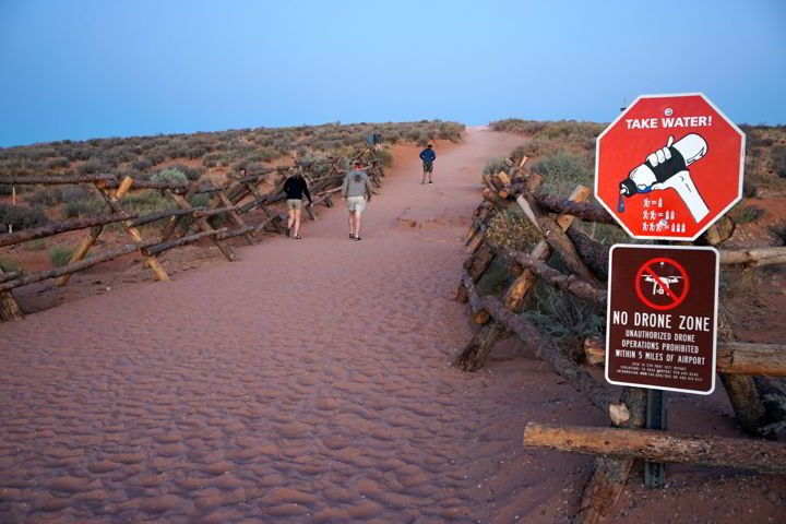 Sign reminds visitors to bring water at Horseshoe Bend trailhead Page Arizona