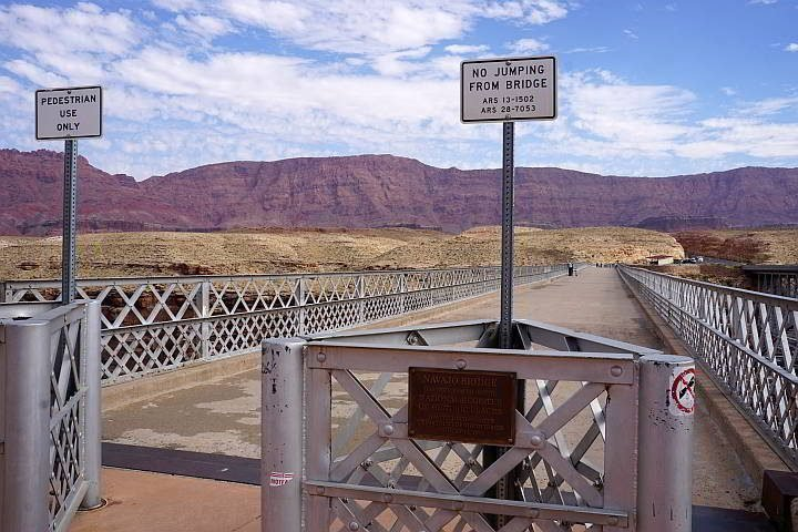 A sign on the Pedestrian Navajo Bridge warns no jumping from bridge