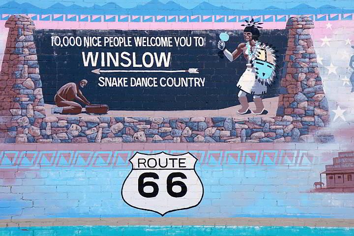 Winslow Arizona mural 10,000 nice people welcome you