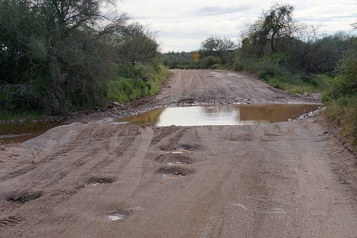 Massive puddle in the dirt road to Superstition Mountains