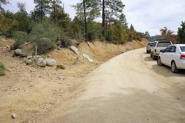 Vehicles parked along Wolf Creek Rd - dirt road