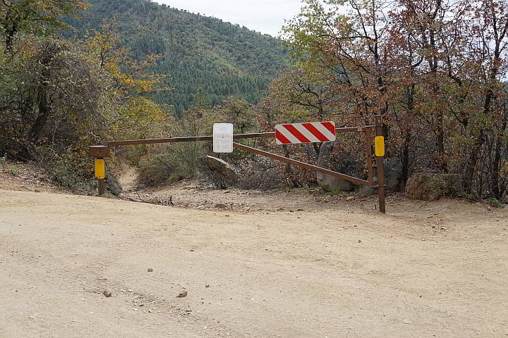 Wolf Creek Falls Trailhead is marked by a gate